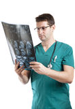 Medical specialist examining patients x-ray Stock Images