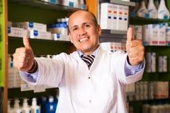 Medical specialist  in farmacy. Friendly medical specialist consulting in farmacy Stock Photography