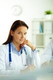 Medical specialist. Portrait of confident female doctor looking at camera in hospital Royalty Free Stock Images