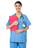 Medical specialist with prescripton report. Medical specialist standing with prescripton report. Stethoscope around her neck Stock Photo