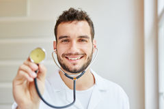 Medical specialist with stethoscope. Smiling Stock Photos