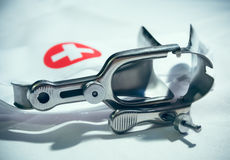 Medical speculum with red cross Stock Photos