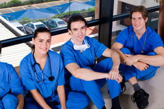 Medical staff. Group of young medical staff relaxin in hospital hallway during break royalty free stock image