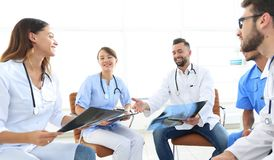 Medical staff discussing x-ray of a patient Royalty Free Stock Photos