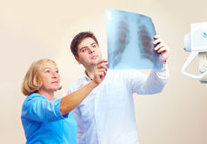 Medical staff discussing the roentgen radiogram in hospital. Medical staff discussing the roentgen radiogram picture in hospital Royalty Free Stock Photography