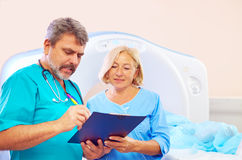 Medical staff filling application form for CT scanner procedure Royalty Free Stock Image