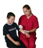 Medical Staff Giving Injection. Medical Staff Giving Boy Insulin Injection royalty free stock photo