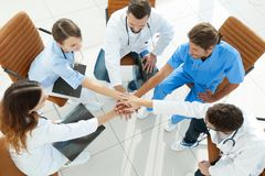 Medical staff hands clasped together,sitting at a Desk Royalty Free Stock Photo