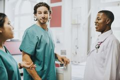 Medical staff having a conversation in the hallway stock photos