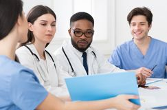 Medical Staff Having Discussion In Meeting Room. Medical Staff Having Discussion In Modern Hospital Meeting Room royalty free stock photography