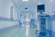 Medical staff in the hospital foyer on the background of technical equipment.  royalty free stock image