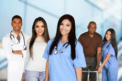 Medical Staff In Hospital. Staff of medical workers with patients in the hospital Royalty Free Stock Image