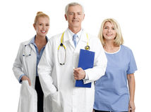 Medical staff. Image of successful healthcare worker. Portrait of medical assistant standing next to mature female doctor and senior doctor. Isolated on white Royalty Free Stock Photos