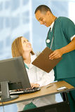 Medical Staff Laughing During Work Time Stock Image