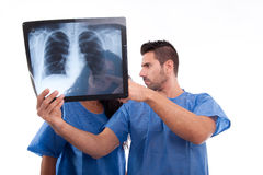 Medical staff looking at x-ray Stock Photo