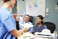 Medical Staff Meeting At Nurses Station Royalty Free Stock Image