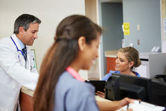 Medical Staff Meeting At Nurses Station Stock Photography