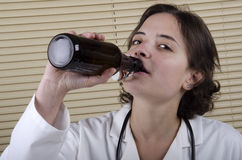Medical Staff Member drinking beer Stock Images