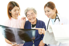Medical staff with old woman Stock Photo