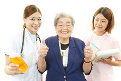 Medical staff with old woman Royalty Free Stock Photos