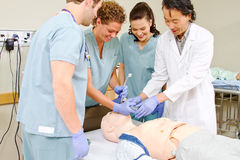 Medical staff practice intubating mannequin. Medical staff being taught intubation Stock Images