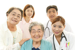 Medical staff with senior women Stock Photography