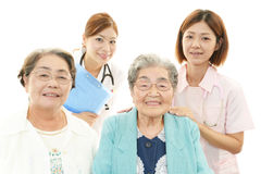 Medical staff with senior women Royalty Free Stock Photo