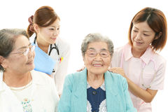 Medical staff with senior women Royalty Free Stock Image