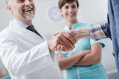 Medical staff welcoming a patient stock photos
