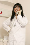 Medical staffer on phone royalty free stock photo