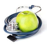 Medical stethoscope and apple Royalty Free Stock Image