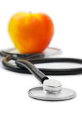 Medical stethoscope and apple Royalty Free Stock Photography