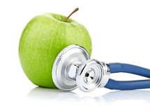 Medical stethoscope and apple isolated on white Royalty Free Stock Photography