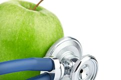 Medical stethoscope and apple isolated on white Royalty Free Stock Images