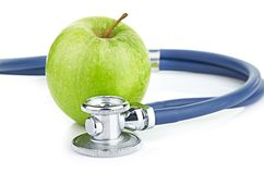 Medical stethoscope and apple isolated on white Stock Photography