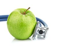 Medical stethoscope and apple  on white Stock Photo