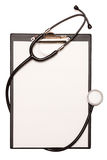 Medical stethoscope and blank clipboard Royalty Free Stock Photos