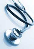 Medical stethoscope on blue Stock Photo