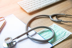 medical stethoscope check heart near a laptop on a wooden table stock images