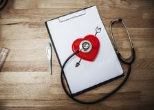 Medical stethoscope check heart on wooden table. Stock Photo