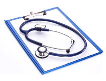 Medical stethoscope with a clipboard Royalty Free Stock Image