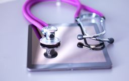 Medical stethoscope with a computer on the desk.  Stock Photography