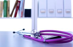 Medical stethoscope with a computer on the desk.  Royalty Free Stock Image