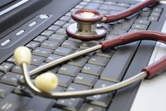 Medical stethoscope and computer keyboard. Symbolic - a stethoscope on a computer keyboard. Medicine, health care and computer technology is an important part of Royalty Free Stock Photo