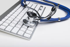 Medical stethoscope on computer keyboard. Concept of computer support. Stock Photography