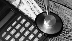 Medical stethoscope on dollar bills. Extra close up Royalty Free Stock Images