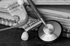 Medical stethoscope on dollar bills. Extra close up Stock Images