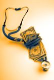 Medical stethoscope dollars Royalty Free Stock Photo