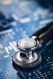 Medical stethoscope and electronics Stock Image