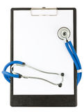 Medical stethoscope and empty clipboard Stock Photo